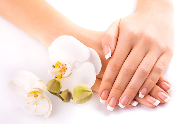 Hands with French manicure, flower